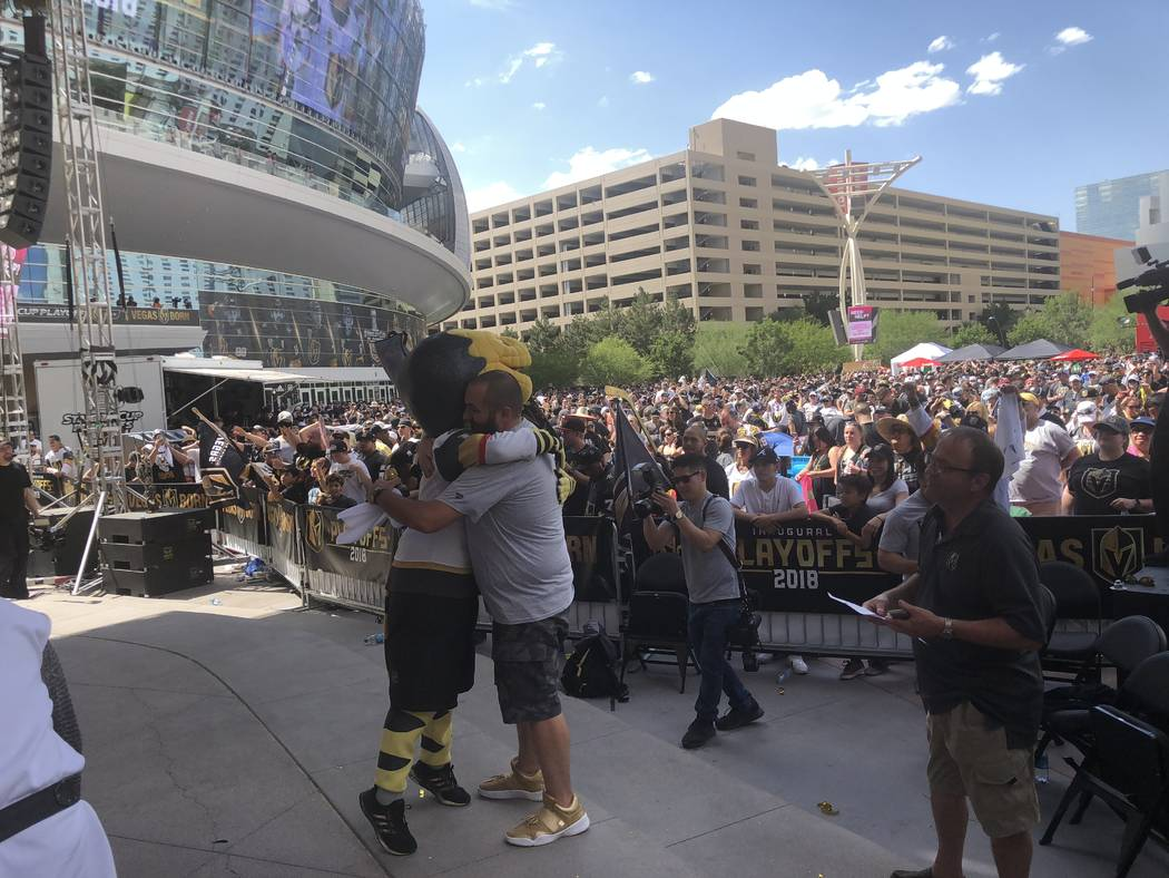 """Wayne """"Big D"""" Danielson and Chance the gila monster hug after the Vegas Golden Knights 2-1 victory Sunday over the Winnipeg Jets to clinch the Western Conference Finals, 4 games to 1. Big D co-emc ..."""