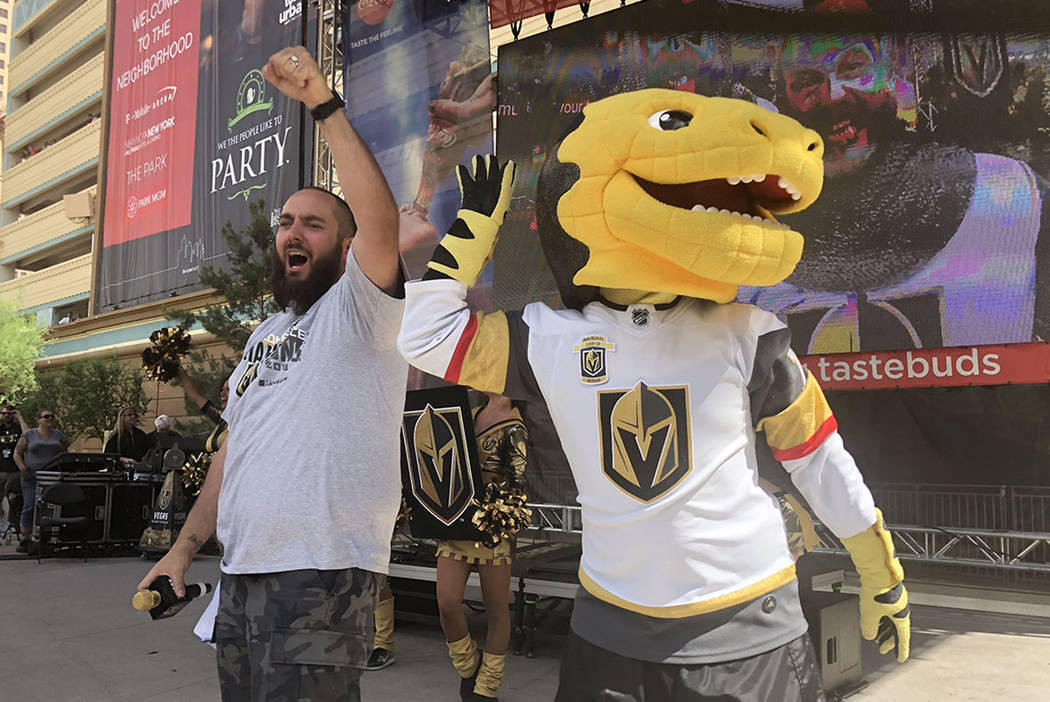 """Wayne """"Big D"""" Danielson and Chance the gila monster celebrate the Vegas Golden Knights 2-1 victory Sunday over the Winnipeg Jets to clinch the Western Conference Finals, 4 games to 1. Big D co-emc ..."""