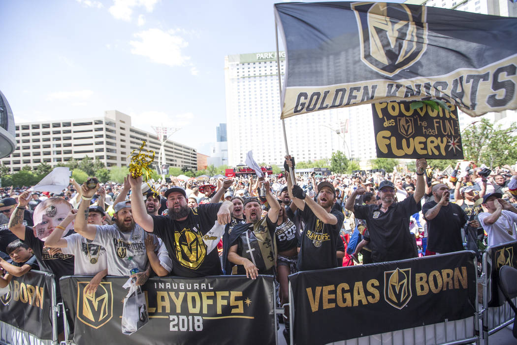 Golden Knights fans celebrate after the Knights defeated the Winnipeg Jets 2-1 during a watch party for Game 5 of the Western Conference Finals at Toshiba Plaza in Las Vegas on Sunday, May 20, 201 ...