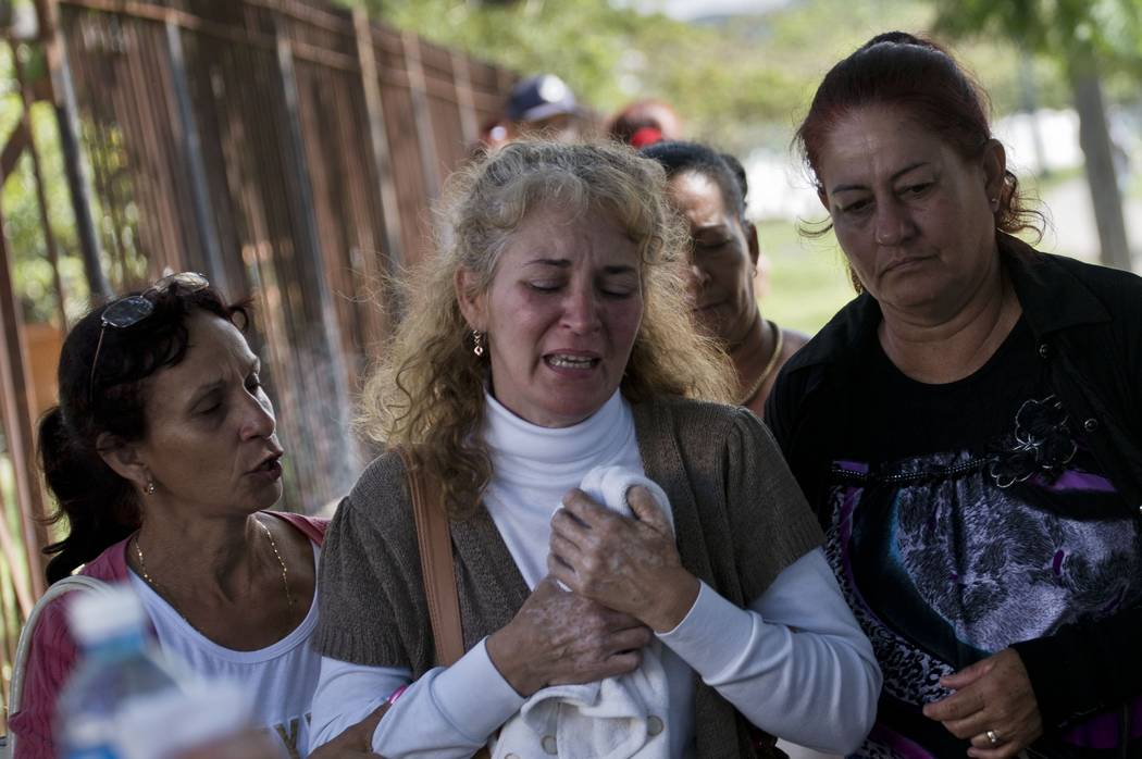 Grieving relatives of passengers who perished in Cuba's worst aviation disaster leave the morgue, in Havana, Cuba, Saturday, May 19, 2018. Investigators are trying to determine why an aging Boeing ...