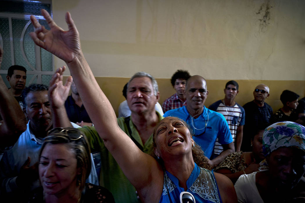 Evangelicals pray and cry during a service in memory those who died in the plane crash in Havana, Cuba, Sunday, May 20, 2018. (AP Photo/Ramon Espinosa)