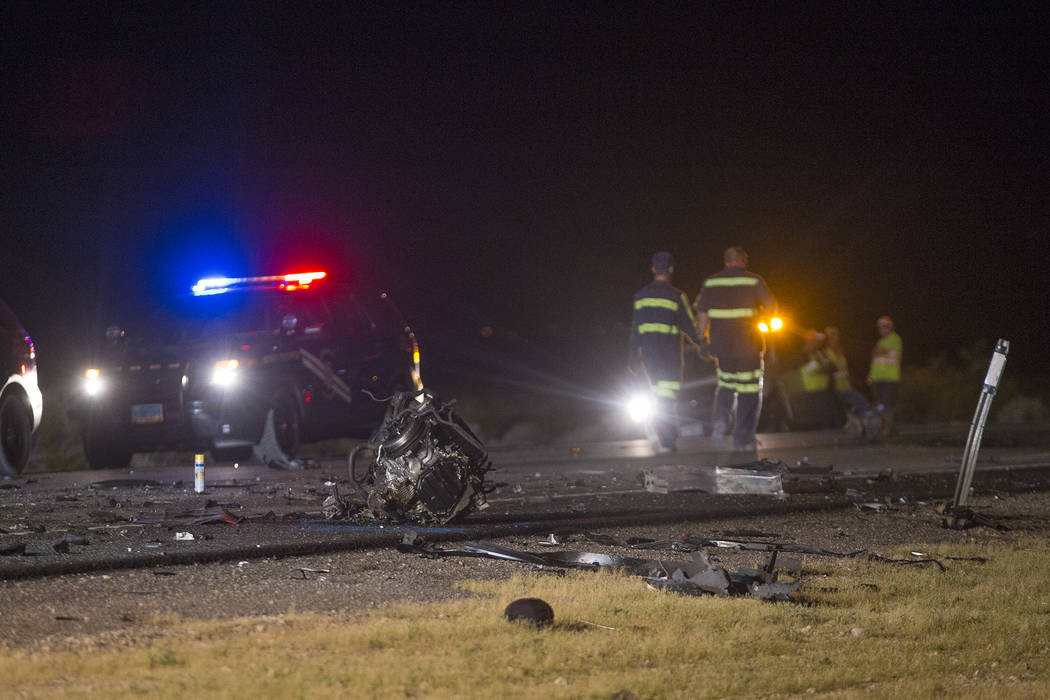 Engine parts scattered on the ground around the multi fatality crash on U.S. Highway 95, near Amargosa Valley in Nye County, Sunday, May 20, 2018. A northbound car was trying to pass a pickup truc ...