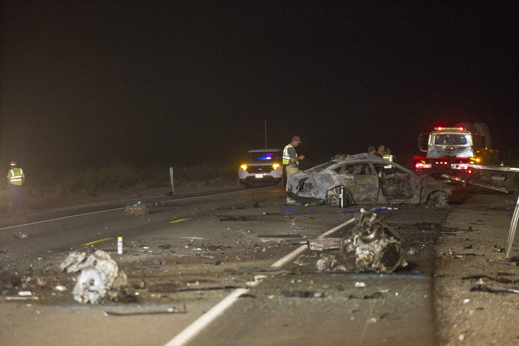 The northbound Nissan that was fully engulfed in flames in the multi fatality crash on U.S. Highway 95, near Amargosa Valley in Nye County, Sunday, May 20, 2018. (Rachel Aston Las Vegas Review-Jou ...