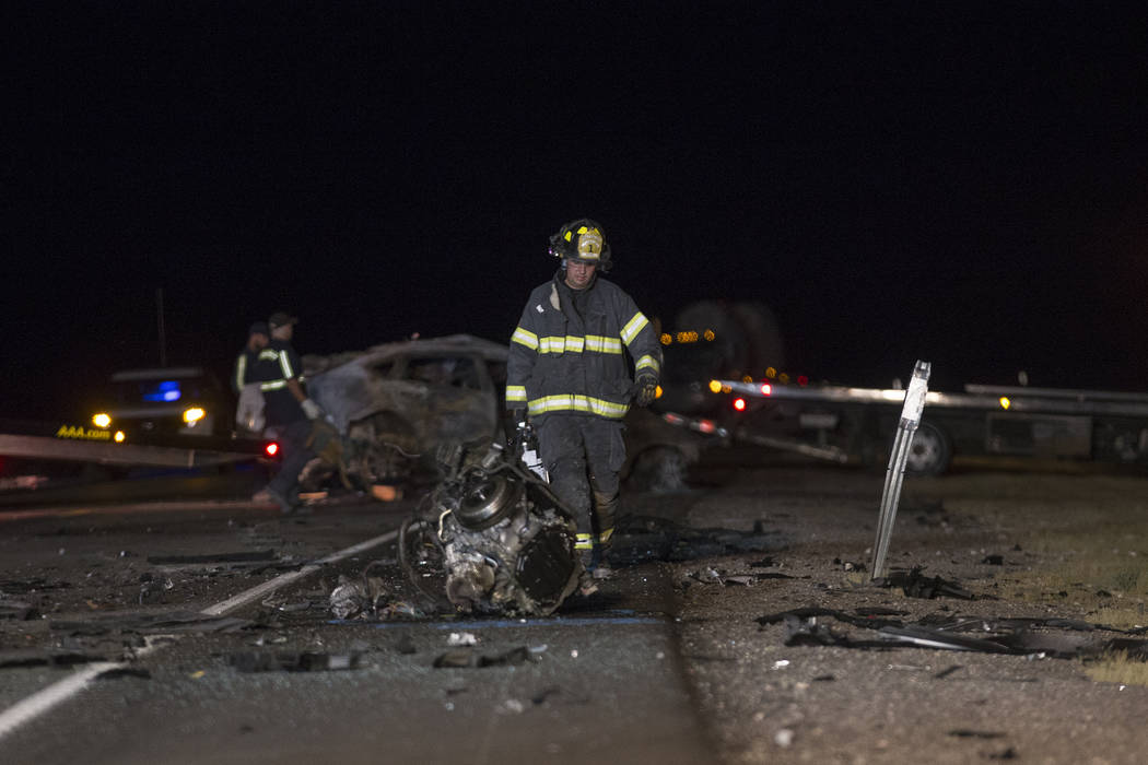 Workers at the scene of the multi fatality crash on U.S. Highway 95, near Amargosa Valley in Nye County, Sunday, May 20, 2018. (Rachel Aston Las Vegas Review-Journal @rookie__rae)
