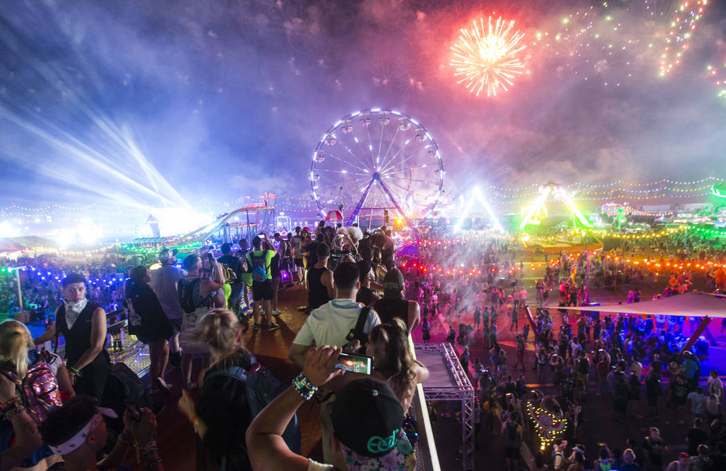 Attendees watch as fireworks go off during the first day of the Electric Daisy Carnival at the Las Vegas Motor Speedway in Las Vegas during the early hours of Saturday, May 19, 2018. Chase Stevens ...