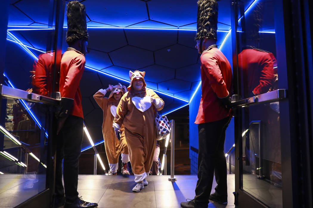 Amanda Bond, center, and Melanie Davis, both of Las Vegas, are greeted by royal guards during a Royal Pajama and Tea Party at Topgolf Las Vegas on Saturday, May 19, 2018. Andrea Cornejo Las Vegas ...