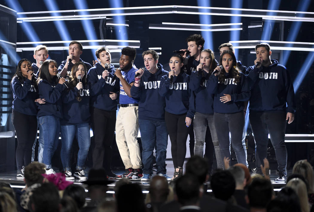"Khalid, seventh from left, and Shawn Mendes, fifth from right, perform ""Youth"" with the Stoneman Douglas choir, of the Marjory Stoneman Douglas High School, at the Billboard Music Awards ..."