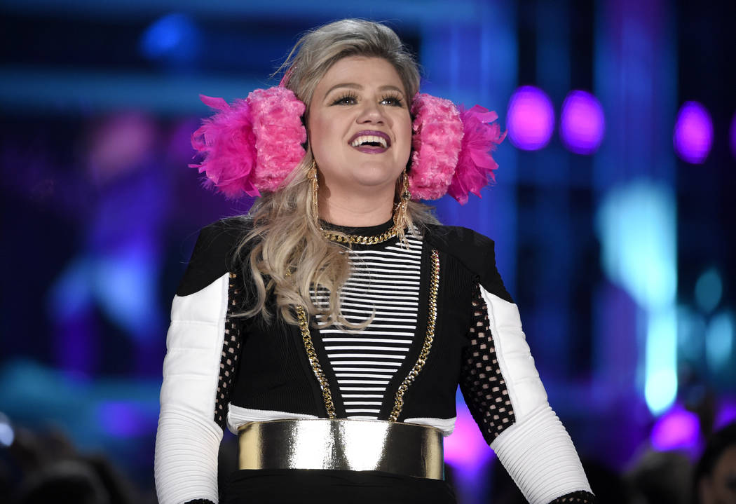 Host Kelly Clarkson introduces a performance by BTS at the Billboard Music Awards at the MGM Grand Garden Arena on Sunday, May 20, 2018, in Las Vegas. (Photo by Chris Pizzello/Invision/AP)