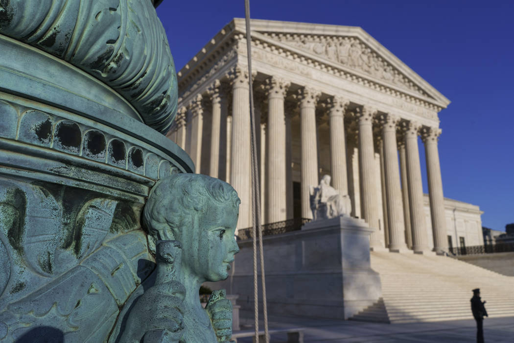 The U.S. Supreme Court says employers can prohibit their workers from banding together to complain about pay and conditions in the workplace. (J. Scott Applewhite/AP)