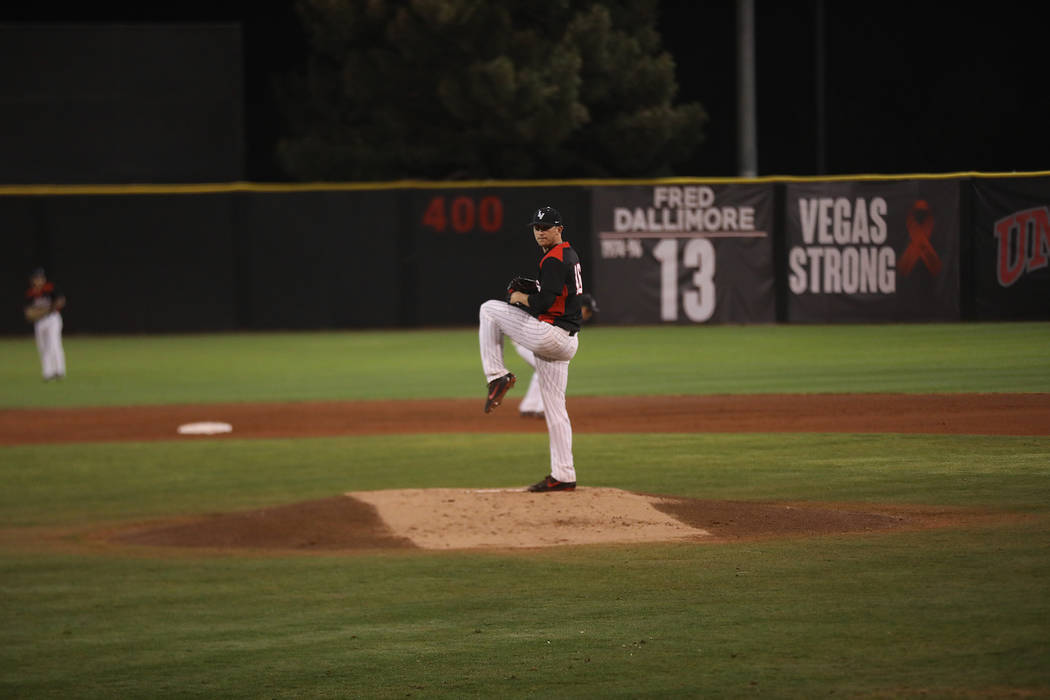 UNLV right-hander Alan Strong delivers a pitch against Iowa at Wilson Stadium on March 9. Photo courtesy of UNLV Athletics.