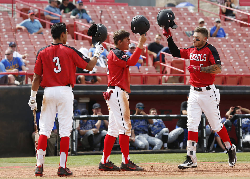 UNLV'S Nick Rodriguez (3), Dillon Johnson (25) and Kyle Isbel (5) celebrate after a run against Air Force during the sixth inning at the Earl Wilson Stadium in Las Vegas on Sunday, April 15, 2018. ...