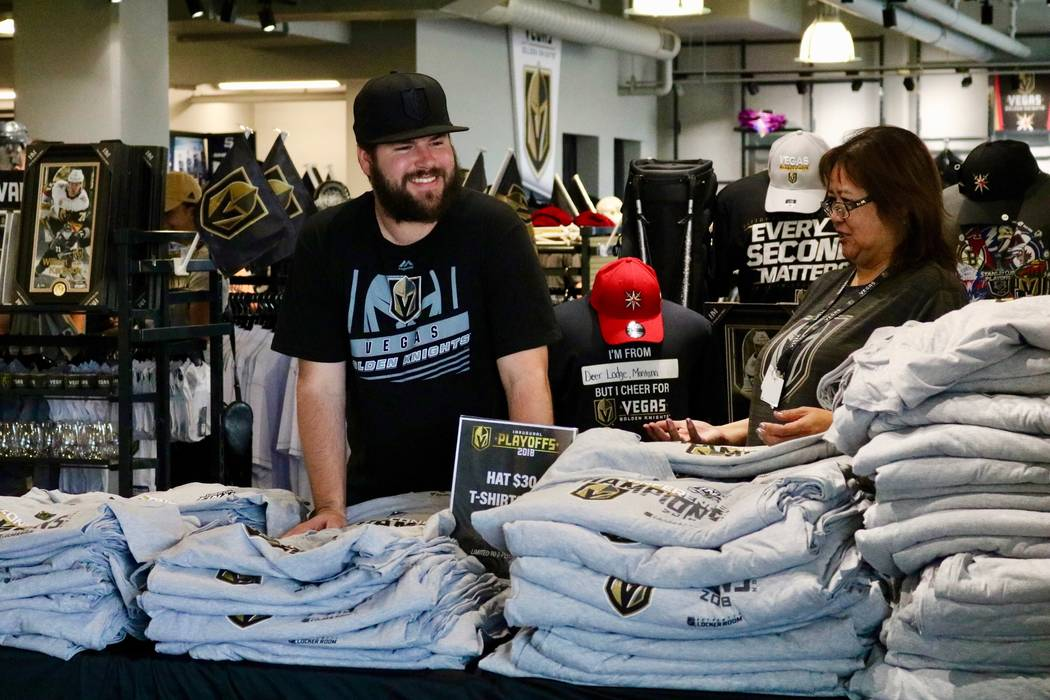 Employees staff a table full of Conference Champions shirts at The Arsenal Pro Shop at City National Arena in Las Vegas, Monday, May 21, 2018. Madelyn Reese/Las Vegas Review-Journal