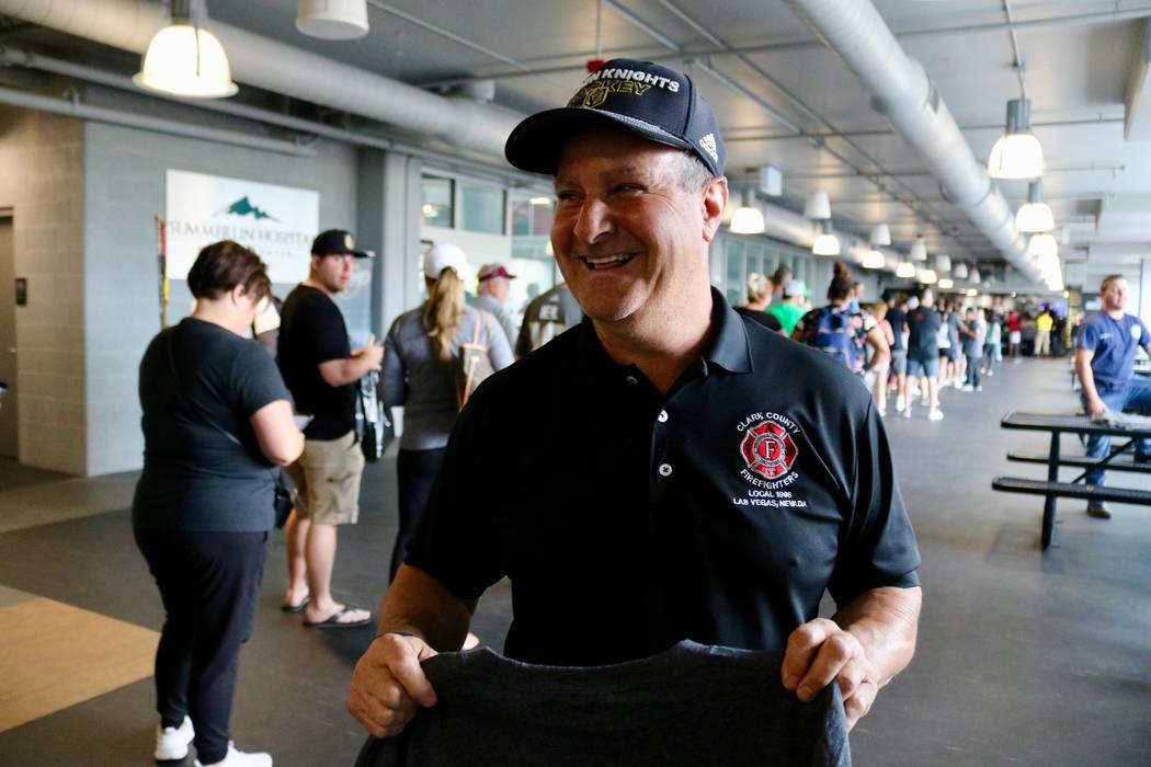 Clark County Fire Department engineer Mark Lepino holds a Knights-themed fire department shirt at City National Arena in Las Vegas, Monday, May 21, 2018. Lepino and others began selling shirts bef ...