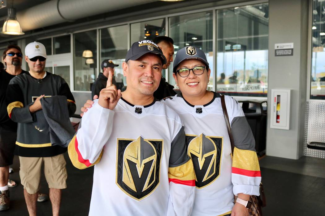 Golden Knights fans Manny, left, and Trixie Olivo sport their jerseys in line in to buy merchandise from The Arsenal Pro Shop at City National Arena in Las Vegas, Monday, May 21, 2018. They were h ...
