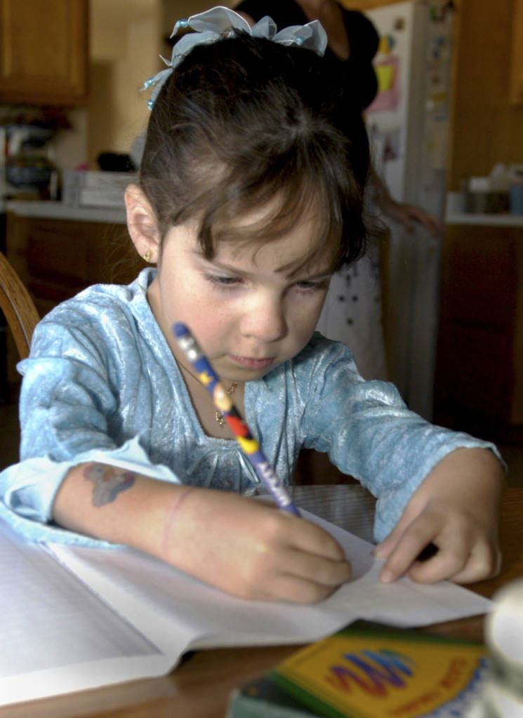 CN/VIEW--Seven year old Jessica Lindley draws at her Las Vegas kitchen table, Thursday, 4/19/07. She has taken 22 flights on Miracle Flight for treatment of a rare muscle disorder. View Photo by S ...