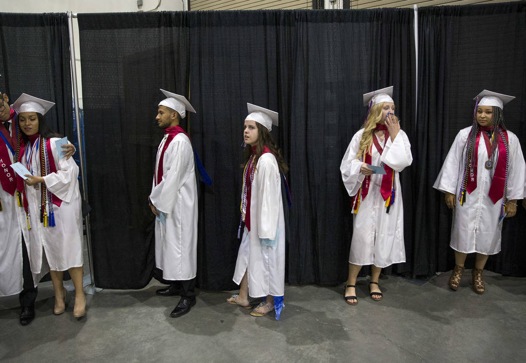 Jessica Lindley, center, stands in line before the start of her commencement ceremony at the Orleans Arena in Las Vegas on Thursday, May 24, 2018. Richard Brian Las Vegas Review-Journal @vegasphot ...