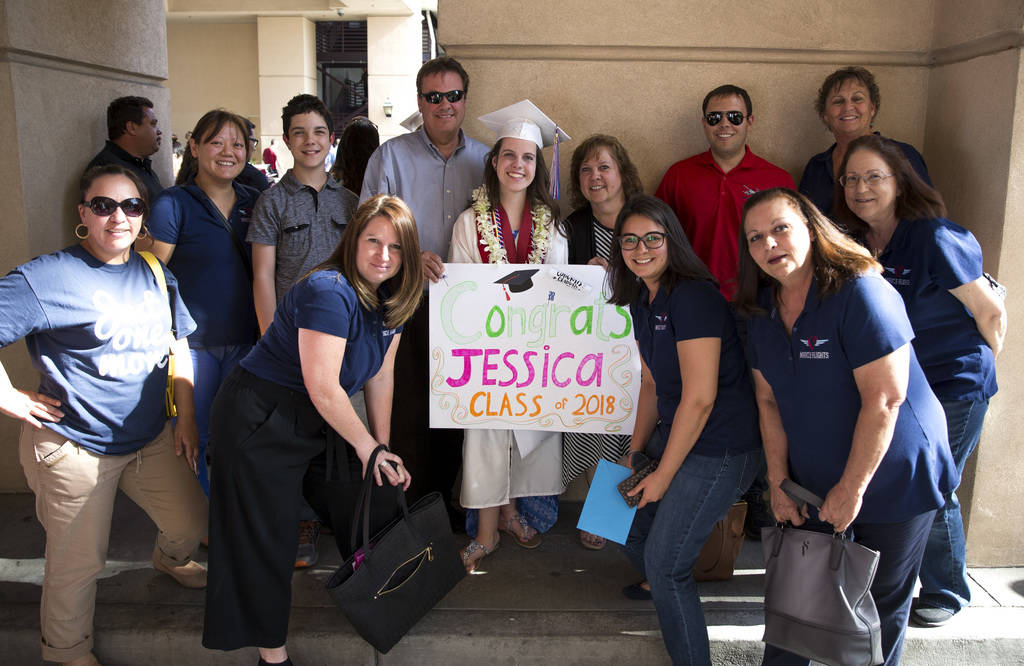 Jessica Lindley, center, poses with her family and members of Miracle Flight following her commencement ceremony at the Orleans Arena in Las Vegas on Thursday, May 24, 2018. Richard Brian Las Vega ...