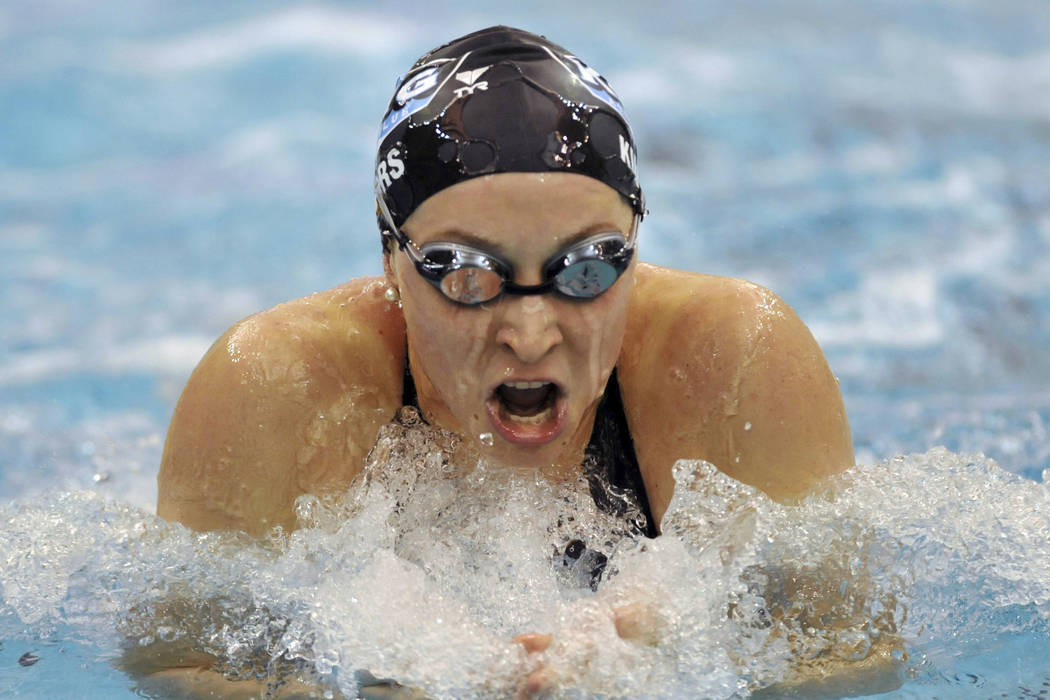 In this Dec. 6, 2008, file photo, Ariana Kukors swims to win the Women's 200-yard breaststroke finals during the 2008 USA Swimming Short Course National Championships at the Georgia Tech Aquatic C ...