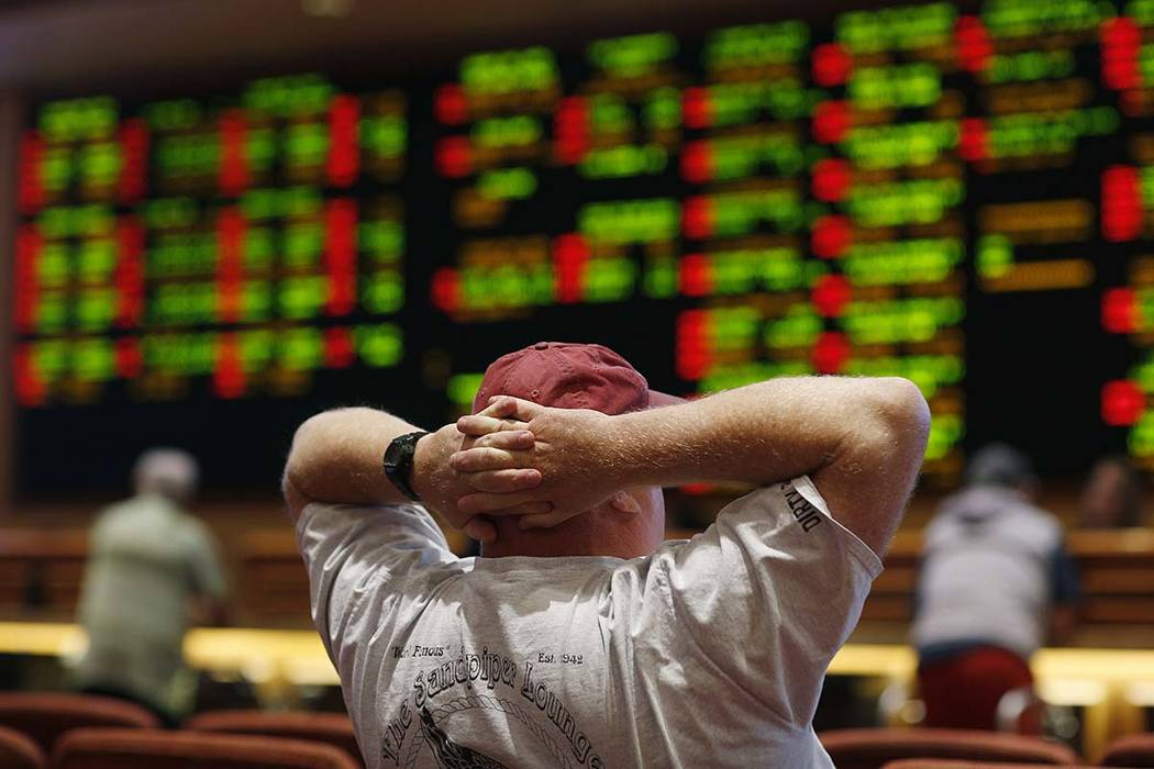 A man watches a game in the sports book at the South Point hotel-casino, Monday, May 14, 2018, in Las Vegas. (AP Photo/John Locher)