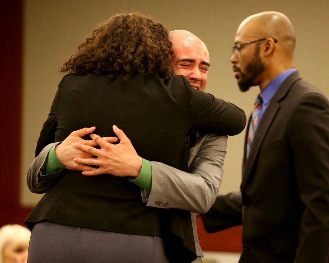 Joshua Honea, a former Las Vegas police explorer, reacts with his attorneys, Monique McNeill and Jonathan MacArthur, during his sentencing at the Regional Justice Center on Monday, May 21, 2018. A ...