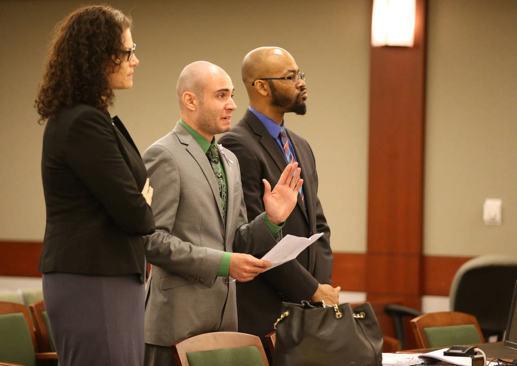 Former Las Vegas police explorer Joshua Honea, center, reads a statement with his attorneys, Monique McNeill and Jonathan MacArthur, before being sentenced at the Regional Justice Center on Monday ...