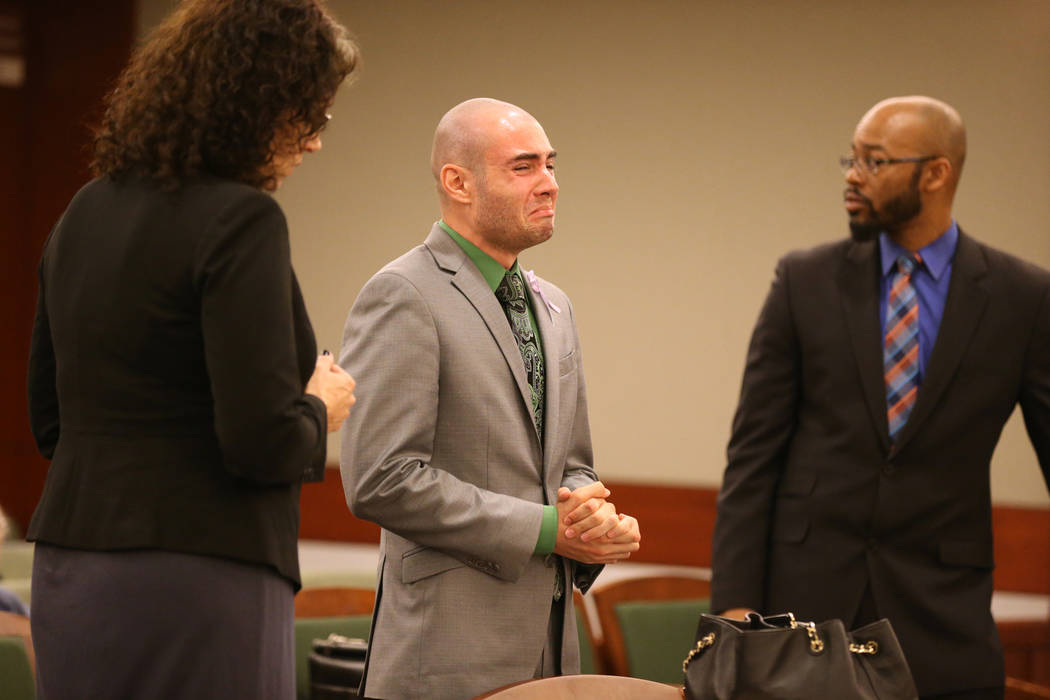 Former Las Vegas police explorer Joshua Honea, center, gets emotional with his attorneys, Monique McNeill and Jonathan MacArthur, before being sentenced at the Regional Justice Center on Monday, M ...