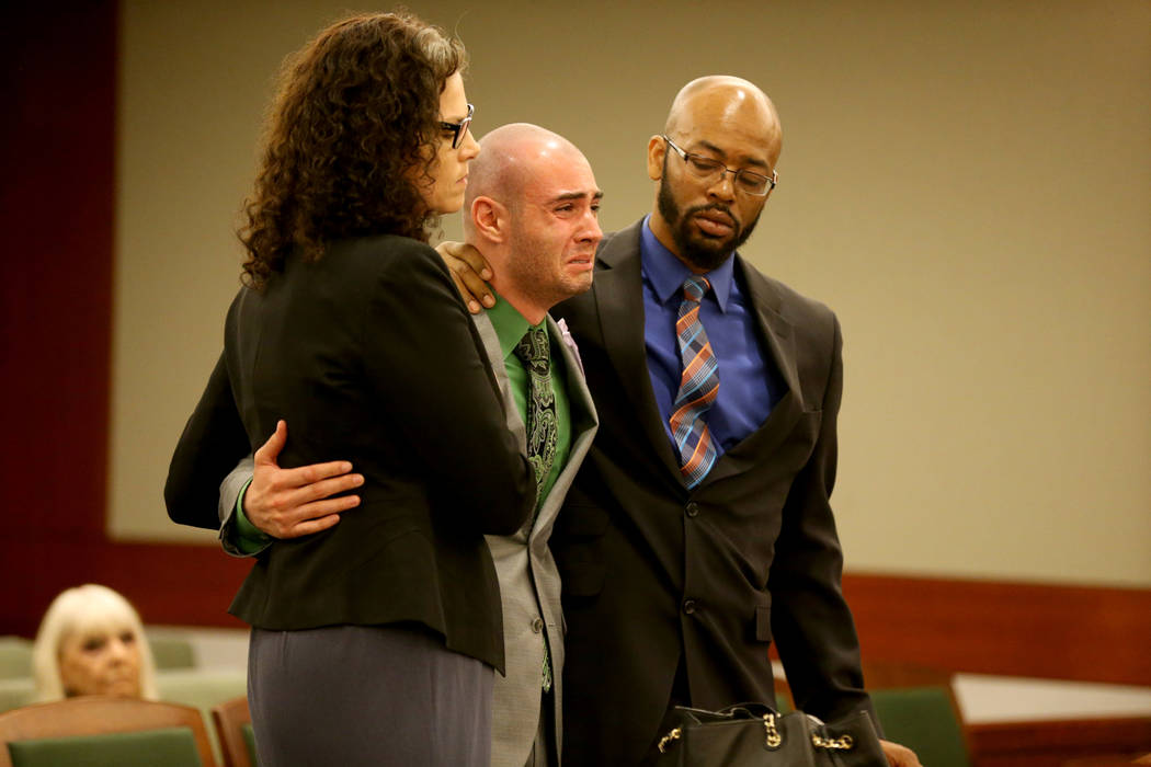 Former Las Vegas police explorer Joshua Honea, center, reacts with his attorneys, Monique McNeill and Jonathan MacArthur, to being allowed to remain free on bail pending appeal after being sentenc ...