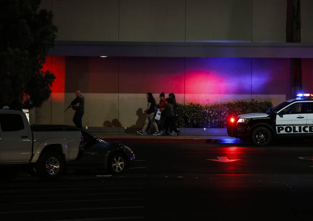 Police escort people outside of Sears at the Boulevard Mall in Las Vegas on Thursday, May 17, 2018. Andrea Cornejo Las Vegas Review-Journal @drea_cornejo