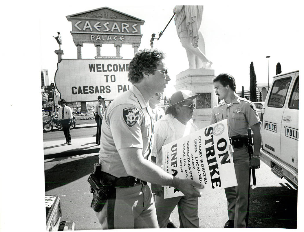 Striker led away by police after he and two others were arrested for obstructing traffic at Caesars north entrance during a Culinary union strike in 1984. (Scott Henry/Las Vegas Review-Journal)