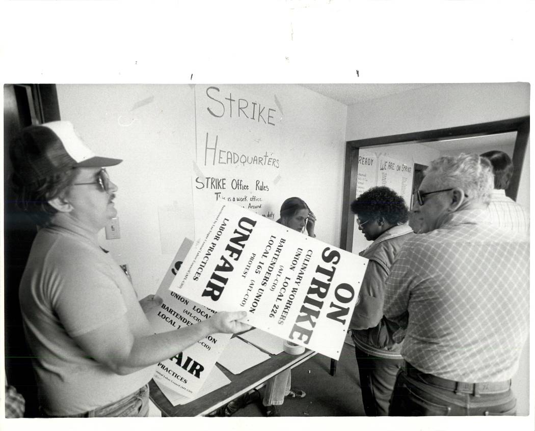 Signs are handed out at strike headquarters during a Culinary union strike in 1984. (Wayne Kodey/Las Vegas Review-Journal)
