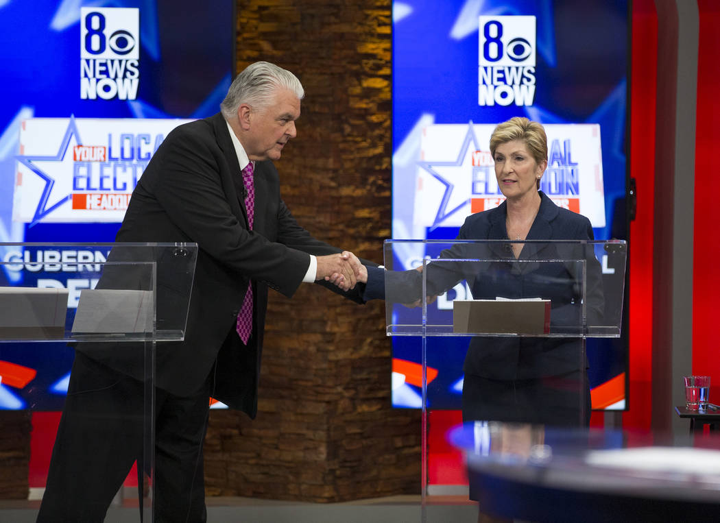Democratic Gubernatorial candidates Steve Sisolak, left, and Chris Giunchigliani shake hands after taking part in a live debate on KLAS-TV channel 8 in Las Vegas on Monday, May 21, 2018. Richard B ...