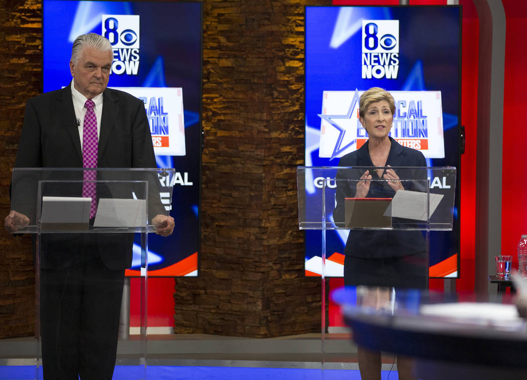 Democratic gubernatorial candidates Steve Sisolak, left, and Chris Giunchigliani debate on KLAS-TV 8 in Las Vegas, Monday, May 21, 2018. (Richard Brian/Las Vegas Review-Journal via AP)