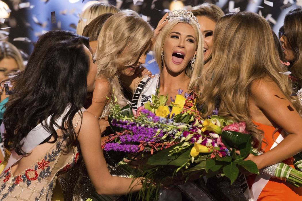 Sarah Rose Summers, Miss Nebraska USA 2018, is crowned Miss USA and congratulated by fellow contestants at the conclusion of the event, Monday, May 21, 2018, in Shreveport, La. (Brittany Elizabeth ...