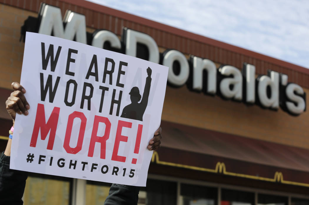 McDonald's workers and supporters rally outside a McDonald's in Chicago, April 15, 2015. On Tuesday, May 22, 2018, Fight for $15 is announcing that it's helping women in several U.S. cities to f ...