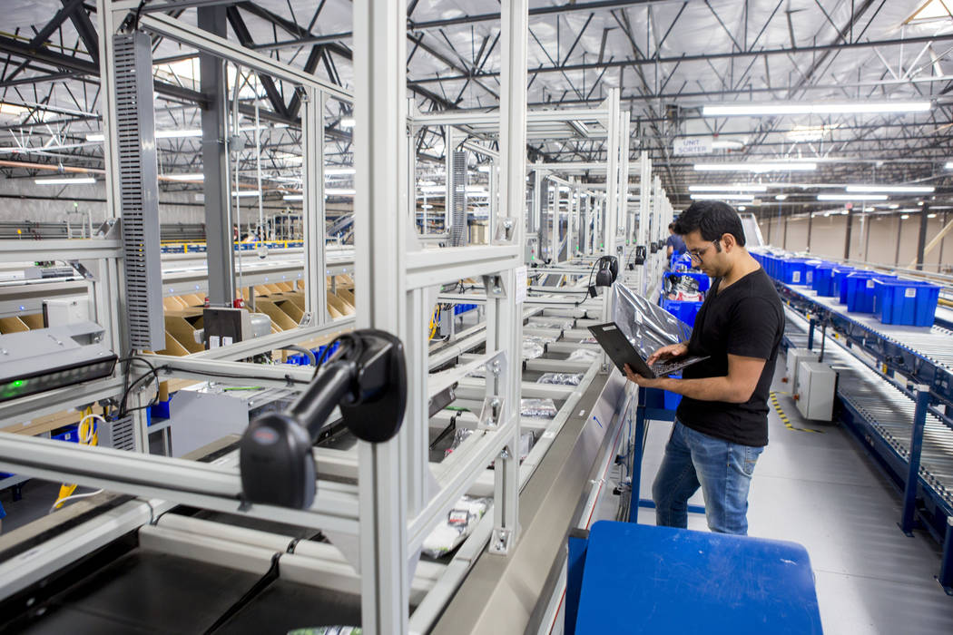 Karanvir Sharma, information technology employee, checks to see the sorting belt works correctly at the Fanatics distribution center in North Las Vegas, Wednesday, Aug. 16, 2017. (Elizabeth Brumle ...