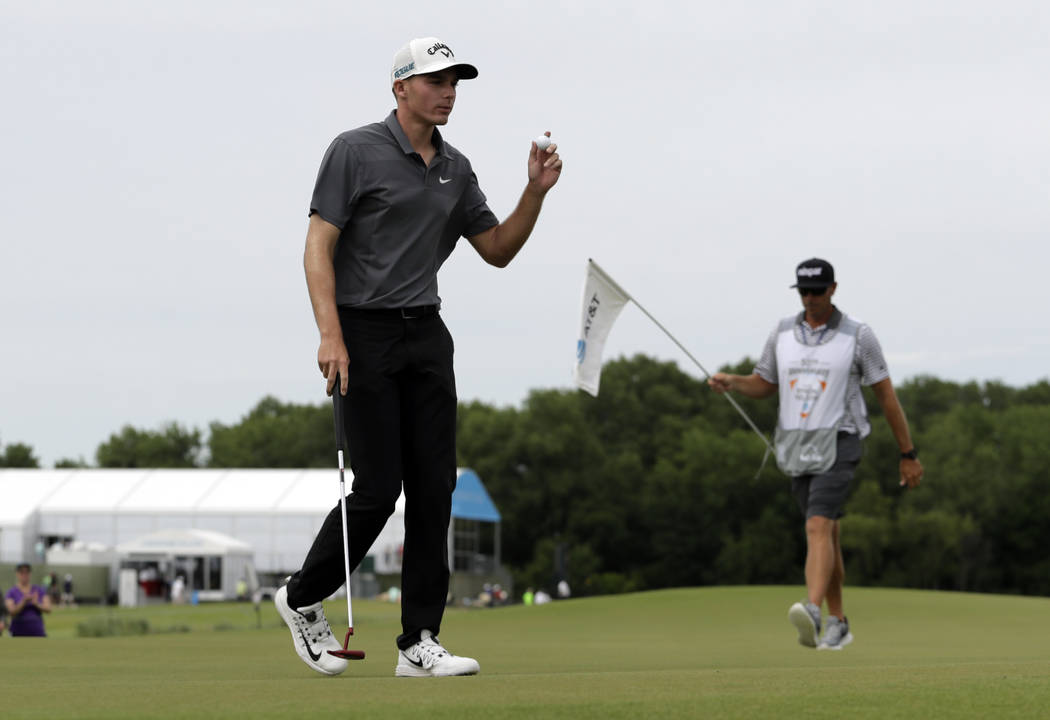 Aaron Wise acknowledges applause from the gallery after paying through the second green during the final round of the AT&T Byron Nelson golf tournament in Dallas, Sunday, May 20, 2018. (AP Pho ...