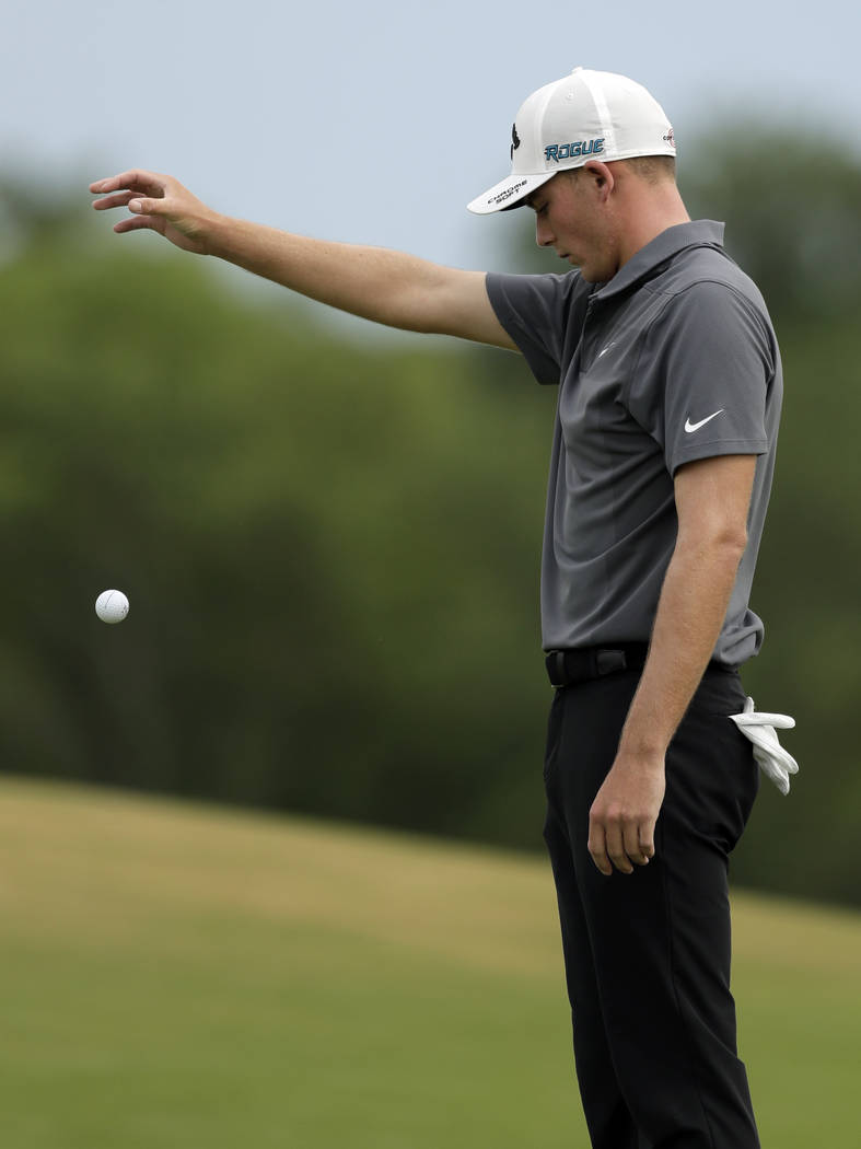 Aaron Wise takes a drop for relief on the fifth fairway during the final round of the AT&T Byron Nelson golf tournament in Dallas, Sunday, May 20, 2018. (AP Photo/Eric Gay)