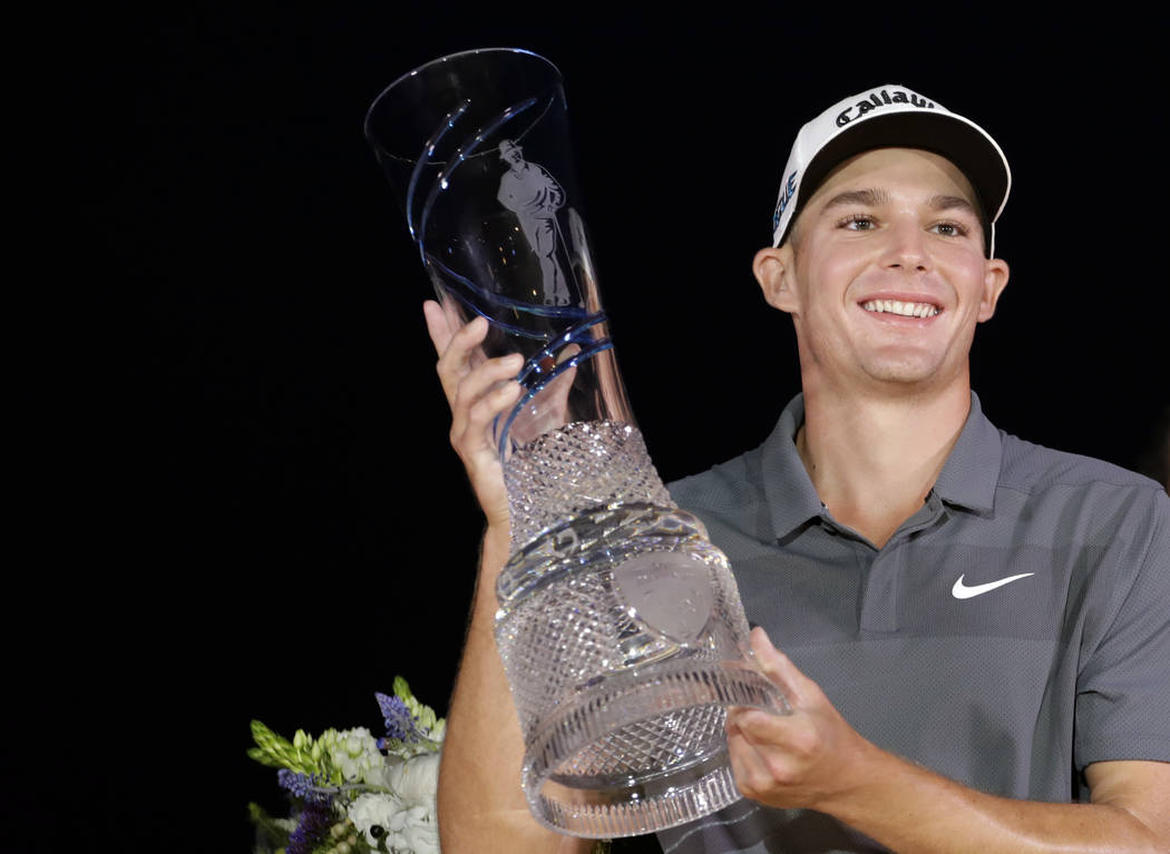 Aaron Wise holds up the trophy after winning the AT&T Byron Nelson golf tournament in Dallas, Sunday, May 20, 2018. (AP Photo/Eric Gay)