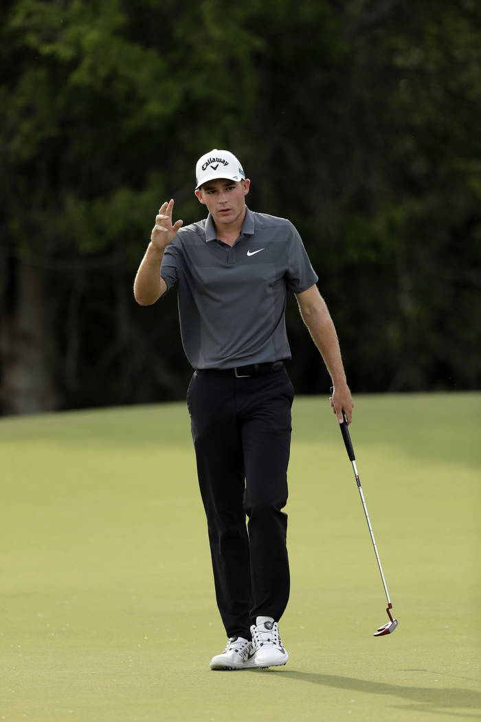 Aaron Wise acknowledges applause from the gallery after sinking a putt for birdie on the ninth green during the final round of the AT&T Byron Nelson golf tournament in Dallas, Sunday, May 20, ...