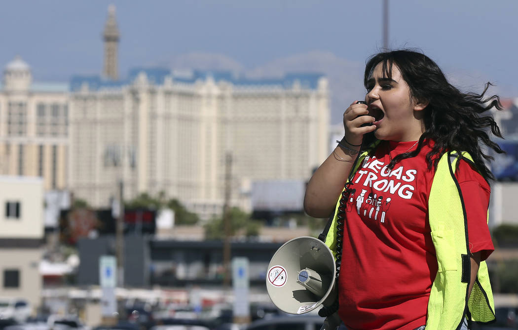 Volunteer Jenifer Murias yells into a megaphone as Culinary Union members file into a university arena to vote on whether to authorize a strike Tuesday, May 22, 2018, in Las Vegas. A potential s ...