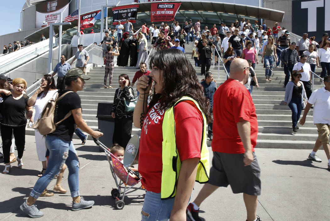 Jenifer Murias, volunteer organizer, shouts slogans as culinary and bartender union workers leave the Thomas & Mack Center in Las Vegas on Tuesday, May 22, 2018, after voting whether they want to ...
