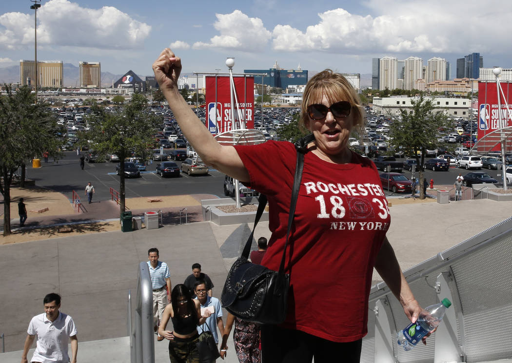Deborah Lalli, a cocktail waitress at Bally's Las Vegas, arrives on Tuesday, May 22, 2018, at the Thomas & Mack Center to vote with culinary and bartender union workers whether they want to go on ...