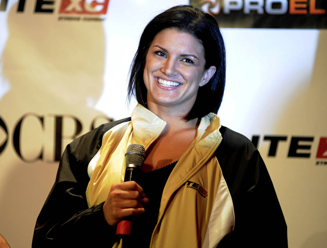 Mixed martial arts fighter Gina Carano speaks during a news conference Thursday, May 29, 2008, in New York. (AP Photo/ Louis Lanzano)