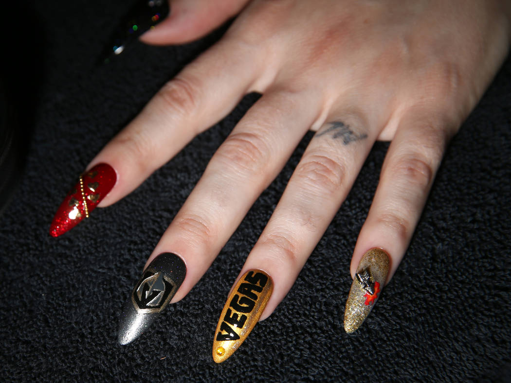 Andrea Lipomi, owner of Feetish Spa Parlor, shows her Vegas Golden Knights-themed nails at her downtown salon Tuesday, May 29, 2018. K.M. Cannon Las Vegas Review-Journal @KMCannonPhoto