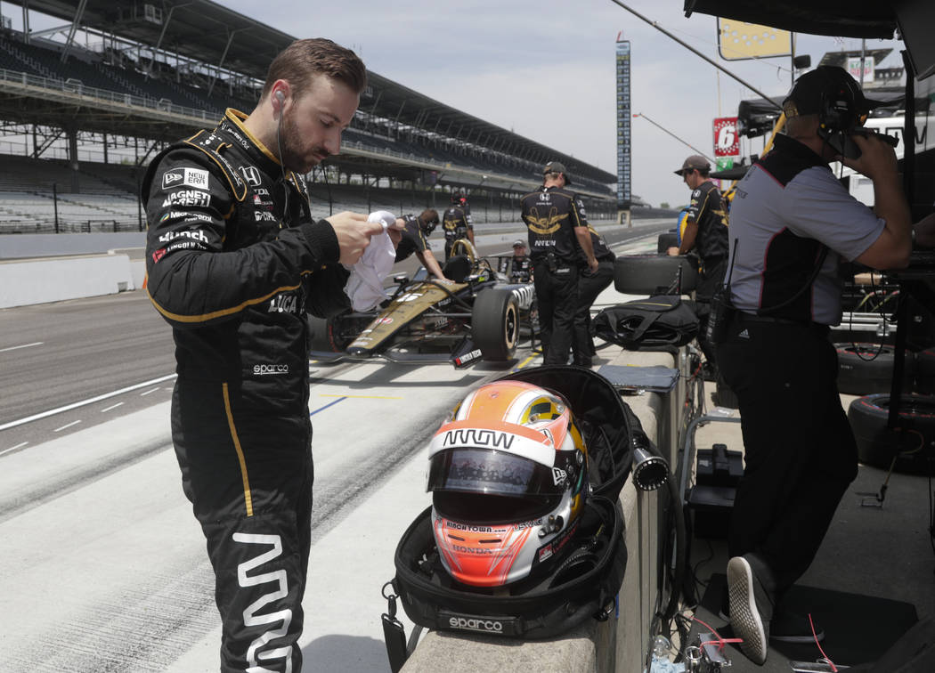 James Hinchcliffe, of Canada, prepares to drive during a practice session for the IndyCar Indianapolis 500 auto race at Indianapolis Motor Speedway in Indianapolis, Thursday, May 17, 2018. (AP Pho ...