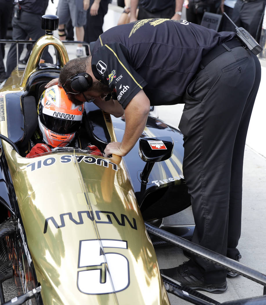 James Hinchcliffe, of Canada, is consoled by a crew member after not qualifying for the IndyCar Indianapolis 500 auto race at Indianapolis Motor Speedway in Indianapolis Saturday, May 19, 2018. (A ...