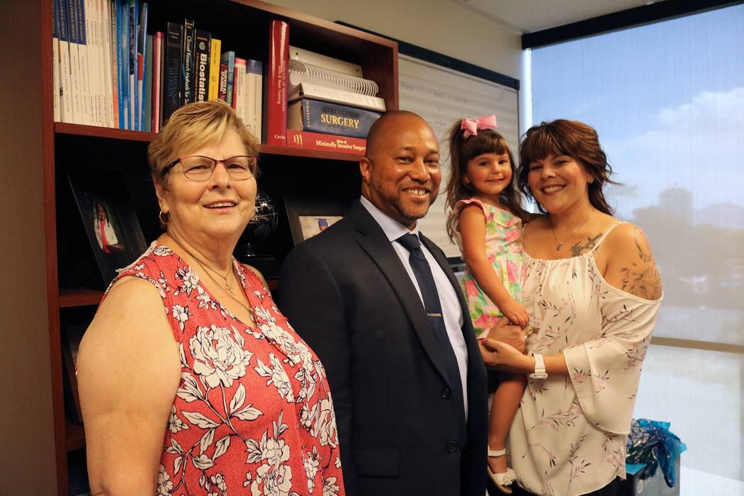 From left to right: Mary Duda, Dr. Charles St. Hill, Faith Duda, and Katie Duda at UNLV Department of Surgery offices in Las Vegas, Tuesday, May 22, 2018. Madelyn Reese/Las Vegas Review-Journal