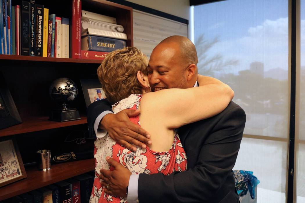 Mary Duda, left, hugs Dr. Charles St. Hill, right, at UNLV Department of Surgery offices in Las Vegas, Tuesday, May 22, 2018. St. Hill performed Duda's pancreatoduodenectomy, or Whipple procedure, ...