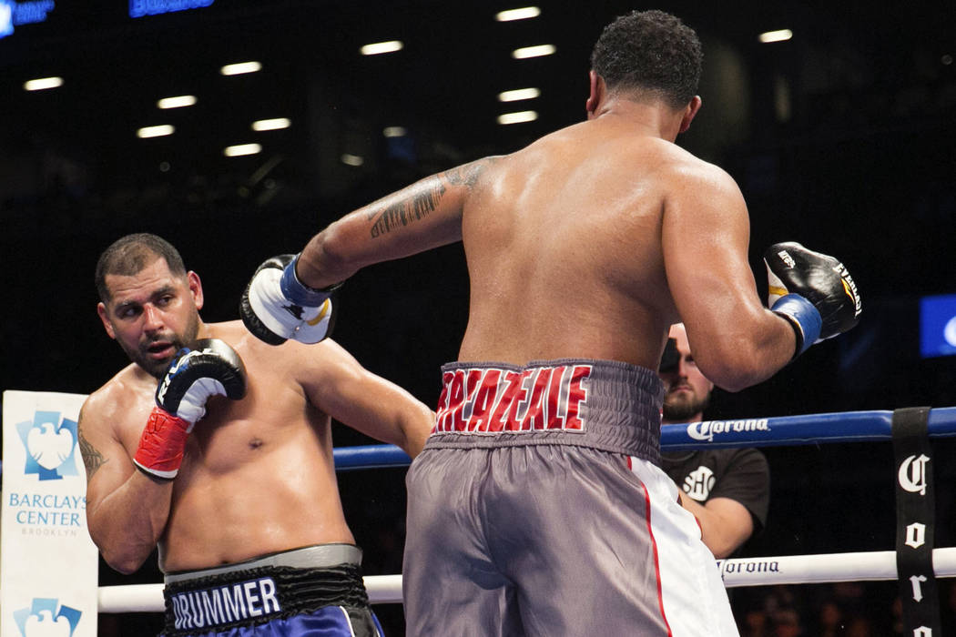 In this Saturday Nov. 4, 2017 file photo, Eric Molina, left, fights Dominic Breazeale, during their heavyweight boxing bout in New York. (AP Photo/Kevin Hagen, File)