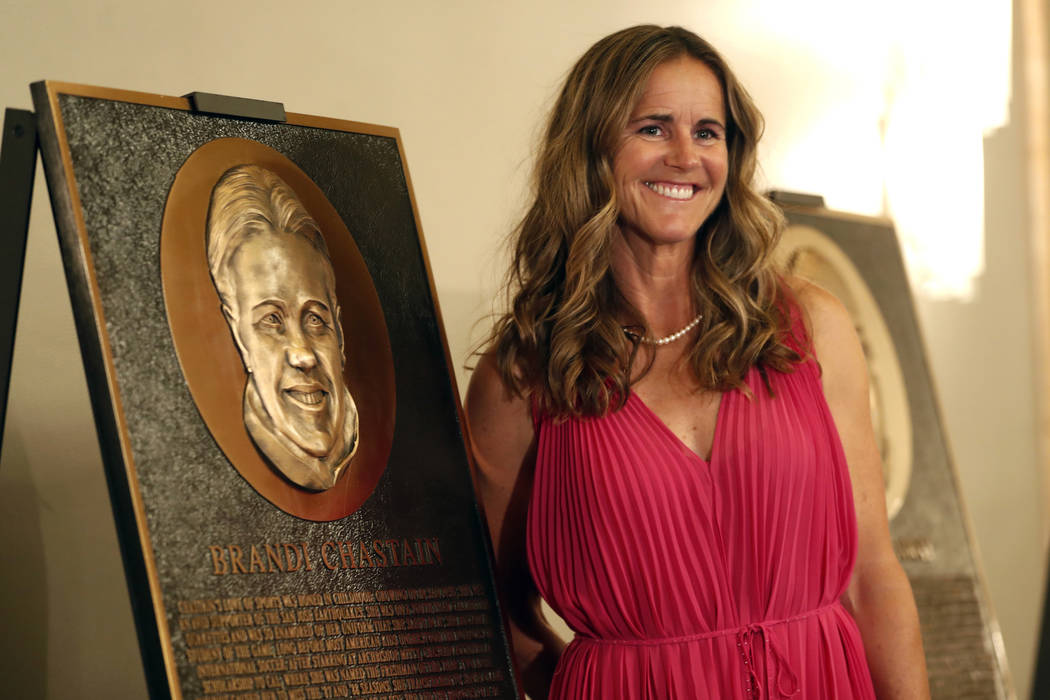 In this photo taken Monday May 21, 2018, Bay Area Sports Hall of Hame inductee Brandi Chastain poses by her plaque during a press conference in San Francisco. Social media is finding little to lik ...